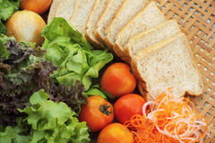 Fresh vegetables salad with whole wheat bread. Stock Images