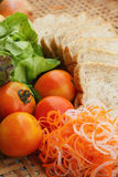 Fresh vegetables salad with whole wheat bread. Stock Photography