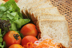Fresh vegetables salad with whole wheat bread. Royalty Free Stock Images