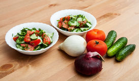 Fresh vegetables for salad. On wooden table Stock Image