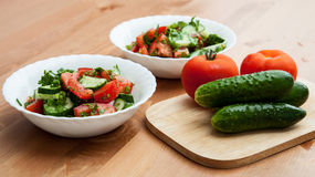 Fresh vegetables for salad. On wooden table Stock Images