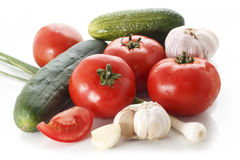 Fresh vegetables. A selection of fresh vegetables, including tomato, garlic, cucumber royalty free stock photography
