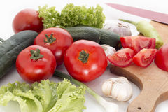 Fresh vegetables. A selection of fresh vegetables, including tomato, garlic, cucumber, green salad stock photography