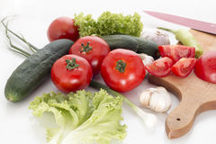 Fresh vegetables. A selection of fresh vegetables, including tomato, garlic, cucumber, green salad royalty free stock photo