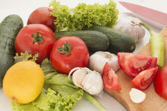 Fresh vegetables. A selection of fresh vegetables, including tomato, garlic, cucumber, green salad royalty free stock photography