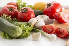 Fresh vegetables. A selection of fresh vegetables, including tomato, garlic, cucumber, green salad,lemon royalty free stock images