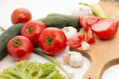 Fresh vegetables. A selection of fresh vegetables, including tomato, garlic, cucumber, green salad, onion stock images