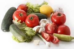Fresh vegetables. A selection of fresh vegetables, including tomato, garlic, cucumber, green salad, onion stock image