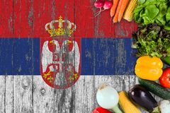 Fresh vegetables from Serbia on table. Cooking concept on wooden flag background royalty free stock photography