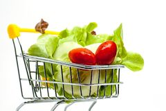 Fresh vegetables in the shopping cart on white background. For healthy food concept stock photo