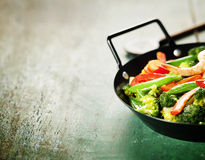 Fresh vegetables and shrimps on pan Stock Images