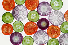 Fresh vegetables slices abstract pattern background,onion, cucum Stock Photo