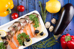 Fresh vegetables and slices fish. On wooden background, top view Stock Photography