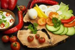Fresh vegetables for snacks with dressing. Dip for vegetables. Healthy diet meal for dinner. Stock Images