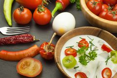 Fresh vegetables for snacks with dressing. Dip for vegetables. Healthy diet meal for dinner. Royalty Free Stock Images