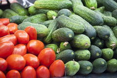 Fresh vegetables  in a spanish market. Tomatoes and  cucumbers: fresh vegetables  in a spanish market Royalty Free Stock Image