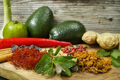 Fresh vegetables and spices, avocado, ginger, mint Royalty Free Stock Photos