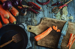 Fresh vegetables, spices and black frying pan for cooking meals. A top view, vintage toning Royalty Free Stock Photography