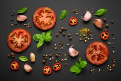 Fresh vegetables and spices. On black background, top view stock photos