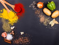 Fresh vegetables, Spices and herbs scattered on dark background. Organic products. Copy space for your text. Fresh vegetables, Spices and herbs scattered on stock photo