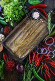Fresh vegetables, spices and herbs in wooden box in rustic style. Raw organic healthy food concept. Red pepper, onions, garlic, basil and rosemary on white Stock Photo