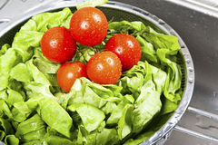 Fresh vegetables splashing in water Royalty Free Stock Images