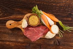 Fresh vegetables and steak meat. Fresh vegetables and steak meat from above on wooden table Stock Photo