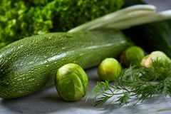 Fresh vegetables still life over white textured background, close-up, flat lay. royalty free stock photography