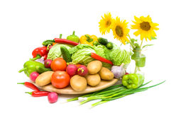Fresh vegetables and sunflowers on a white background Stock Images