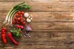Fresh vegetables on a table. Fresh health bio vegetables on a rustic wooden table royalty free stock image