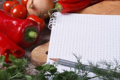 Fresh vegetables on the table and a notebook for menu Stock Image