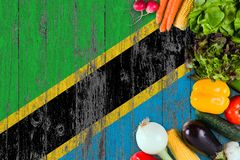 Fresh vegetables from Tanzania on table. Cooking concept on wooden flag background stock images