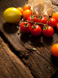 Fresh vegetables on a textured wooden table with sunlight. Space for text. Royalty Free Stock Photos
