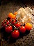Fresh vegetables on a textured wooden table with sunlight. Warm light and wooden textures. Stock Photo