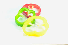 Fresh vegetables Three sweet Red, Yellow, Green Peppers isolated Stock Images