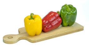 Fresh vegetables Three sweet Red, Yellow, Green Peppers isolated on white Stock Images