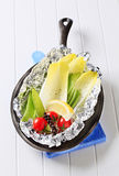 Fresh vegetables on tinfoil in skillet Royalty Free Stock Images