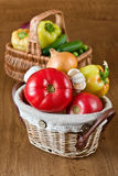 Fresh vegetables and tomatoes in baskets Stock Photo
