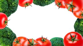 Fresh vegetables, tomatoes and broccoli around the edges on white background, isolate, copyspace. Fresh vegetables, tomatoes and broccoli around the edges on Stock Photography