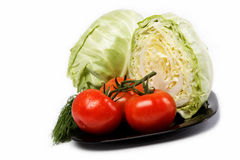 Fresh vegetables. Tomatoes, cabbage, and dill. Fresh vegetables. Tomatoes, cabbage, and dill on a white background Stock Images