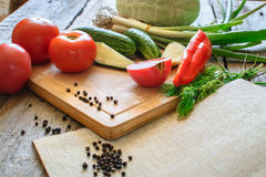 fresh vegetables tomatoes, cucumber, chili pepper, dill on wooden background. Stock Photo