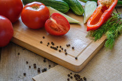 fresh vegetables tomatoes, cucumber, chili pepper, dill on wooden background. Stock Image
