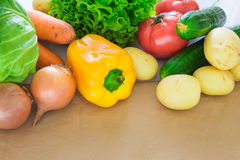 Fresh Vegetables. Tomatoes, Potatoes, Cucumber, Peppers, Onions, Lettuce, Carrots, Cabbage On A Table With Paper Stock Photo