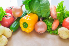 Fresh Vegetables. Tomatoes, Potatoes, Cucumber, Peppers, Onions, Lettuce, Carrots, Cabbage On A Table With Paper Royalty Free Stock Photo