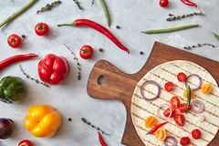 Fresh vegetables and tortilla on a wooden board Stock Image