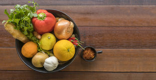 Fresh vegetables in a tray, Courgettes, onion, orange, lemon, to. A tray of Fresh vegetables on a wooden table, Courgettes, onion, orange, lemon, tomato, potato Stock Image
