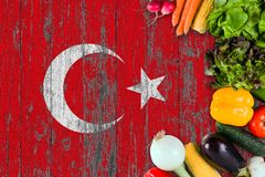 Fresh vegetables from Turkey on table. Cooking concept on wooden flag background stock images