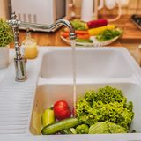 Fresh vegetables under water stream Stock Images
