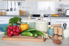 Fresh vegetables and utensils for cooking classes. On wooden table Royalty Free Stock Photography