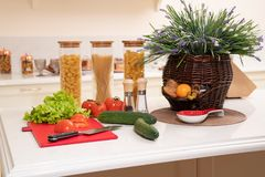Fresh vegetables and utensils for cooking classes on white table. Spice, pasta and fruits stock image